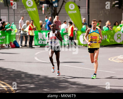 Jonny Mellor competing for GB and Samuel Chelanga competing for USA, in the 2018 Elite Men's London Marathon.They finished 14th and 15th respectively - Stock Image