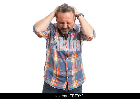 Man holding hands on head as painful headache concept isolated on white background - Stock Image