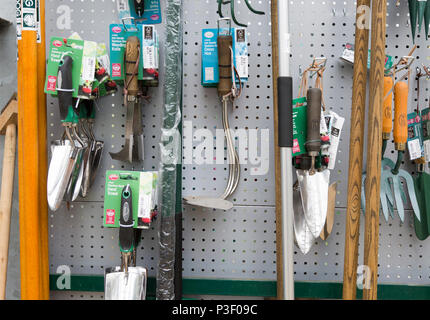 Display of gardening tools on sale, The Walled garden plant nursery, Benhall, Suffolk, England, UK - Stock Image