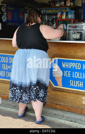 rear view of obese woman at a fast food take-away, Skegness, England, UK - Stock Image