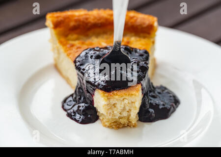 Cashew and almond based vegan cheesecake with blueberry sauce - Stock Image