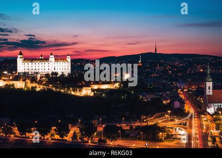 Night panorama of Bratislava city. Landscape with Bratislava castle, after sunset. Capital city of Slovakia - Stock Image