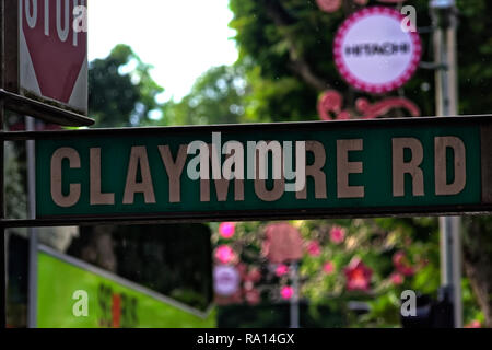 Street sign for Claymore Road, Singapore with stop sign at road junction behind - Stock Image