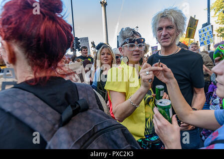 London, UK. 20th October 2018. At Trafalgar Square people are partying at the end of the People's Vote March calling for a vote to give the final say on the Brexit deal or failure to get a deal. They say the new evidence which has come out since the referendum makes it essential to get a new mandate from the people to leave the EU. With so many on the march the crowding meant many failed to reach Parliament Square and came to a halt in Whitehall. Peter Marshall/Alamy Live News - Stock Image