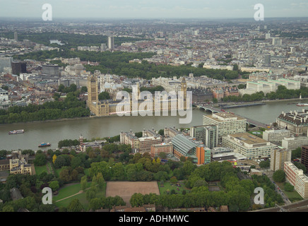 Aerial view of the Houses of Parliament and Whitehall looking over the River Thames and St Thomas' Hospital in London - Stock Image