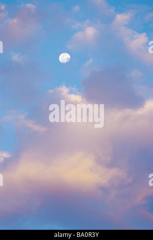 Cloudscape with moon - Stock Image