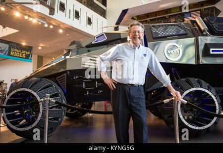 Jim Green, director of NASA's Planetary Science Division, poses for a photo with the Mars rover concept, developed - Stock Image