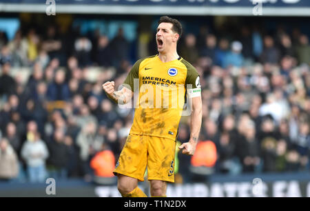 Lewis Dunk of Brighton celebrates the win during the FA Cup quarter final match between Millwall and Brighton & Hove Albion at The Den London . 17 March 2019 Editorial use only. No merchandising. For Football images FA and Premier League restrictions apply inc. no internet/mobile usage without FAPL license - for details contact Football Dataco - Stock Image