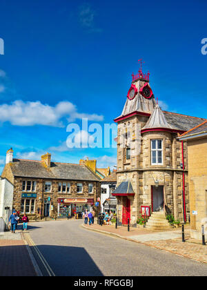 14 June 2018: Marazion, Cornwall, UK - The village centre in summer, with the Town Hall and its clock tower. - Stock Image