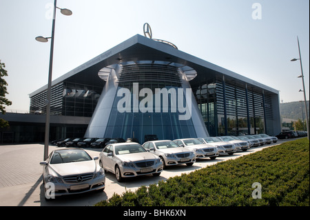 image of mercedes benz world home exterior with car line up - Stock Image