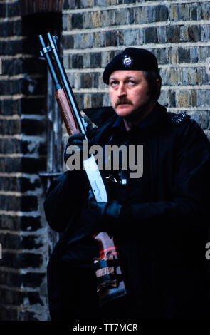 Police. Armed British Police. London England. 1986 British Police armed with guns. 1986 Photographs from a series photographed in 1986 showing the arming of the British Police, traditionally at the time not armed.Special armed police guard Lambeth Magistrates Court in London during an IRA trial. Seen using a Remington shot gun. - Stock Image