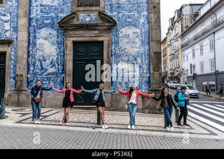 group of girls in front of Capela das Almas church, Porto, Portugal - Stock Image
