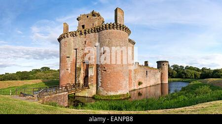 Caerlaverock Castle on a bright sunny day an idyllic scene in Dumfries and Galloway near the Scottish Border. - Stock Image