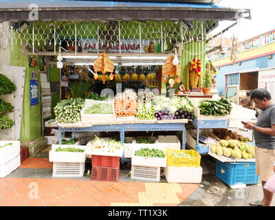 Outside of a shop selling mostly fruits and vegetables in the ethnic district Little India in the city state of Singapore. - Stock Image