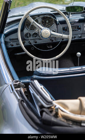 Steering wheel and dashboard of a vintage Mercedes car - Stock Image