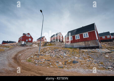 Greenland. Scoresby Sund. Ittoqqortoormiit. Road heading up the steep hill. - Stock Image