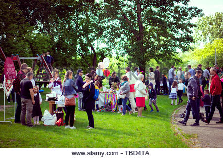 Adults and children at a playground during a - Stock Image