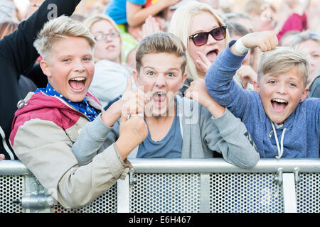 Portsmouth, Hampshire, UK. 23rd August, 2014. Victorious Festival - Saturday, Southsea, Hampshire, England. Three - Stock Image