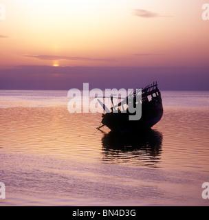 Dhow at sunset Manama Bahrain - Stock Image