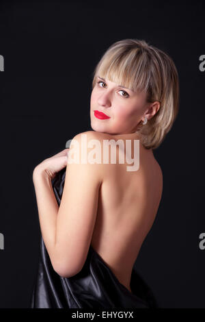 Young sensual woman beauty portrait on black background - Stock Image