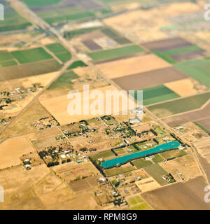 Aerial View of a Lake in an Agricultural Community - Stock Image