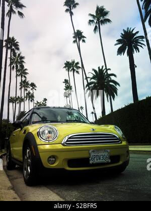 Colorful yellow mini car on Rodeo Drive, Beverly Hills, Los Angeles, California, USA - Stock Image