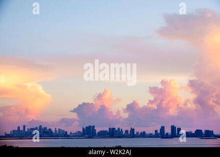 Miami Florida Biscayne Bay downtown city skyline cumulonimbus storm clouds sunset - Stock Image