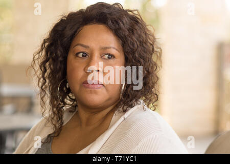Middle age woman in deep thought - Stock Image