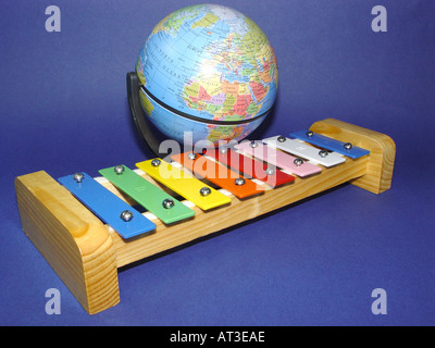xylophone with a globe as symbol for the world of the music - Stock Image