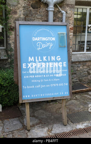 Dartington Dairy and Milking Experience at The Shops, a rustic retail park at Dartington.Milk a cow or goat. DIY milking. - Stock Image