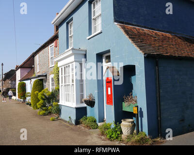 A house in the village of Portchester, England, with a Royal Mail post box on the external wall. - Stock Image