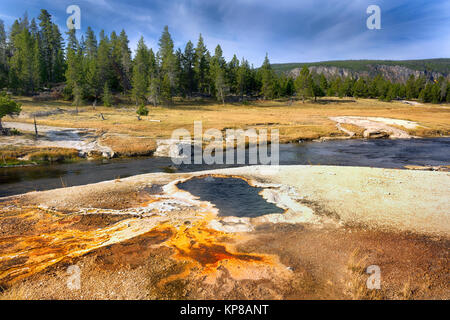 Firehole River, Yellowstone National Park, Wyoming, USA. The Firehole River flows through several significant geyser - Stock Image