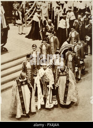 King George the sixth at Westminster Abbey on May 12 1937 showing the king wearing his coronation robes the crown and carrying the orb and sceptre published in a coronation souvenir book published by the Daily Express dated 1937 - Stock Image