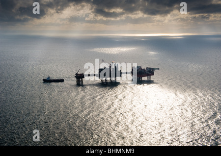 image of douglas gas platform and standby vessel in the irish sea - Stock Image