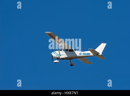 Cessna 172S flying out of Inverness Airport, Highland Region Scotland. - Stock Image