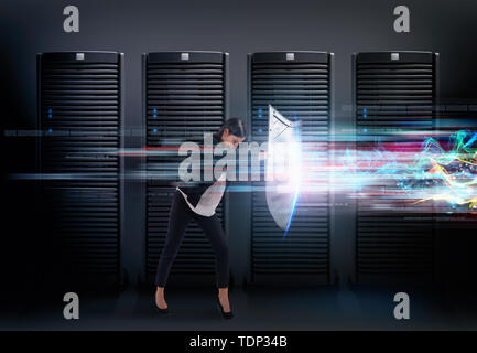 Concept of safety in a data center room with database server. Woman with shield defends against hacker attacks - Stock Image