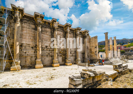 Athens, Greece - September 17 2018: Tourists sightsee at the ancient West Wall of Hadrian's Library at the Roman Agora near the Plaka district - Stock Image