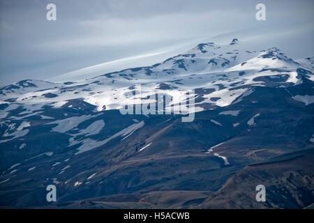 Overcast sky over snowy mountains of Skaftafell National Park, Iceland - Stock Image