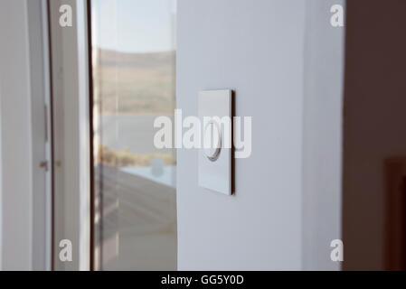 Door buzzer on modern glass doorway - Stock Image