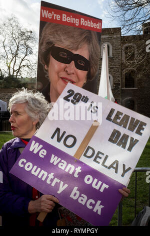 On the day that MPs in Parliament vote on a possible delay on Article 50 on EU Brexit negotiations by Prime Minister Theresa May, an elderly lady UKIP Leaver protests on College Green, on 14th March 2019, in Westminster, London, England. - Stock Image