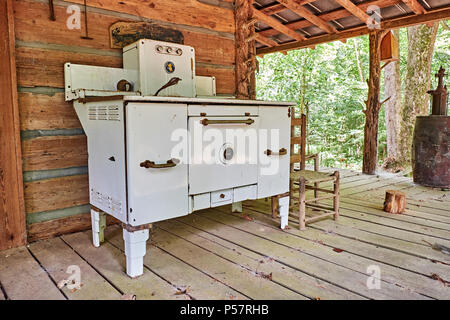Vintage antique wrought iron wood or coal burning stove made by Home Comfort, circa 1864 located in rural Alabama. - Stock Image