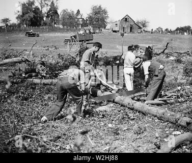 Work starts at 'Tuggwelltown.' Workers are busy clearing land for the construction of the government-owned project popularly called 'Tuggwelltown,' a.k.a. Greenbelt, Maryland. It is a project of the Rehabilitation Administration ca. October 15, 1935 - Stock Image