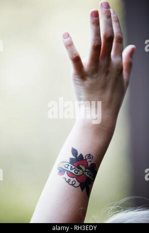 Child hand with tattoo - Stock Image