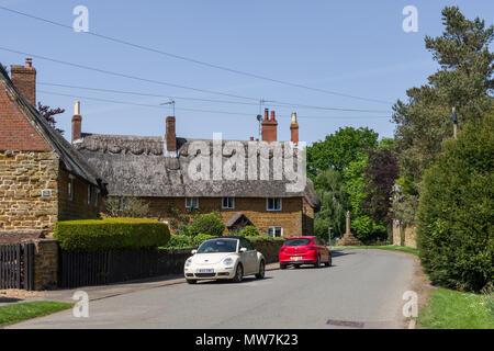 Street scene in the pretty Northamptonshire village of Great Brington, UK - Stock Image