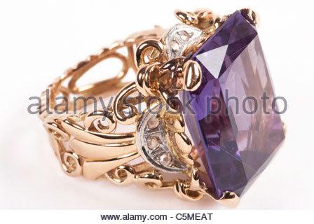Gold ring amethyst stone - Stock Image