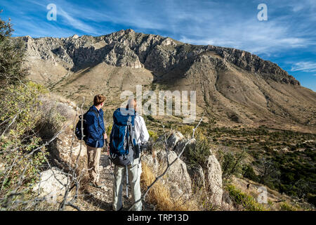 Hikers admiring view, Guadalupe Peak Trail, Guadalupe Mountains National Park, Texas USA - Stock Image