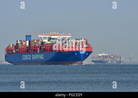 COSCO Shipping Aries & CMA CGM Bougainville upstreaming river elbe - Stock Image