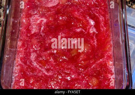 fruit sauce, desert, cheese cake. strawberry, rhubarb - Stock Image