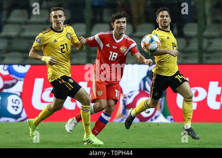 Brussels, Belgium. 22nd Mar, 2019. BRUSSELS, BELGIUM - MARCH 21, 2019: Belgium's Timothy Castagne (L), Dries Mertens (R) and Russia's Yuri Zhirkov (C) in action in their UEFA Euro 2020 qualifying football match at King Baudouin Stadium. Anton Novoderezhkin/TASS Credit: ITAR-TASS News Agency/Alamy Live News - Stock Image