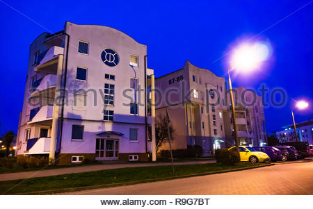 Poznan, Poland - November 16, 2018: Apartment building on the Stare Zegrze district by night. - Stock Image
